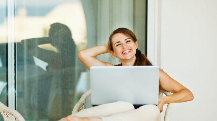 Happy Woman on laptop Hormones Balanced